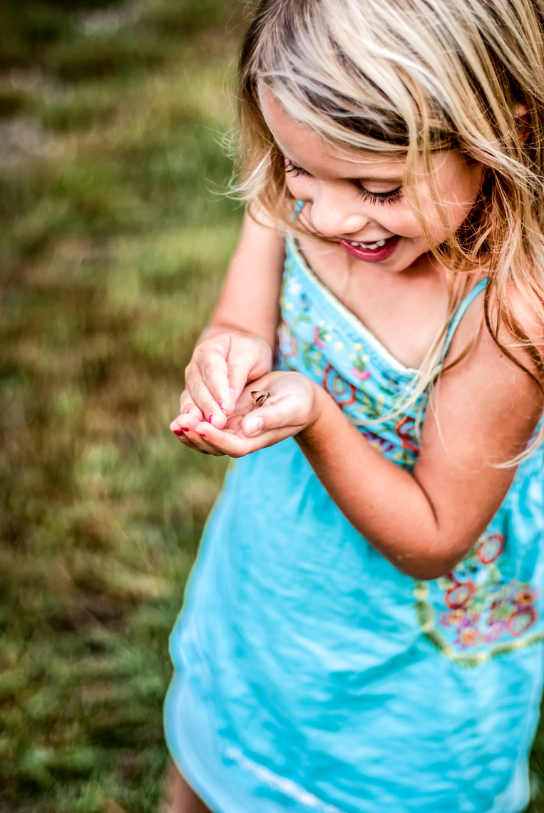 Girl playing with small butterfly